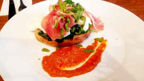 Mojo Eggs of Poached Eggs with Romesco, Prosciutto, Cavelo Nero, Mojo Verde & Sourdough